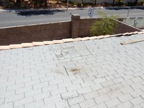 Here you see a flat rooftop with shingles being used. This material is not compatible with the slope of this roof. You can see an area where the roof is becoming soft and spongy from the material not sheading water properly.